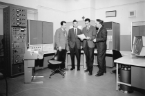 Reactor Monitor and Control Computer System. L to R Dr. A. Pearson, C.J. Lennox, J.S. Milton, N.S. Wells.